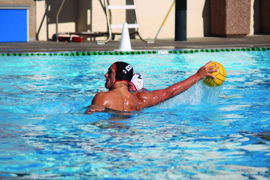 Felix Brozyna-Vilim '17 looks to pass the ball to a teammate during a game. Brozyna-Vilim is one of the multiple Wolverine water polo college commits. Others are Sam Krutonog '18 (University of Southern California) and Luke Henriksson '17 (UCLA).