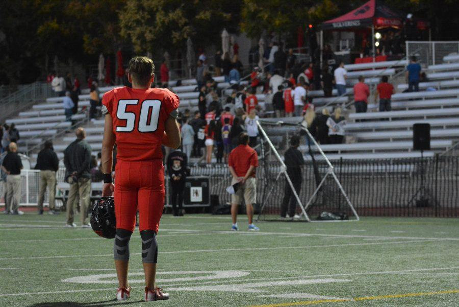 Cam Welther '17 stands for the National Anthem before the Wolverines' Sept. 23 contest against Dominguez. (Credit: Aaron Park / Chronicle)