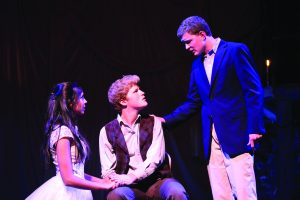 Jack Nordstrom '19, right, as Marius and Maya Hinkin '18, left, as Cosette comfort Henry Platt '17, middle, as he is dying. Photo by Pavan Tauh/Chronicle