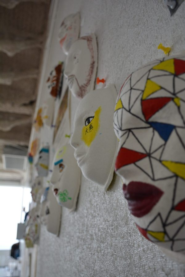 Students painted masks to reveal how they felt others perceive them as well as how they view themselves. Credit: Ryan Albert/Chronicle