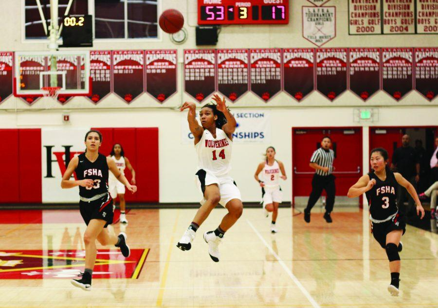 Jayla Rufus-Milner '18 fires off a buzzer-beater during the team's 59-24 victory over FSHA on Jan. 5.  The team is 14-1 and ranked 17th in the nation as of press time.  It will play against Alemany, the state's 15th-ranked team, on Jan. 19. Credit: Pavan Tauh/Chronicle