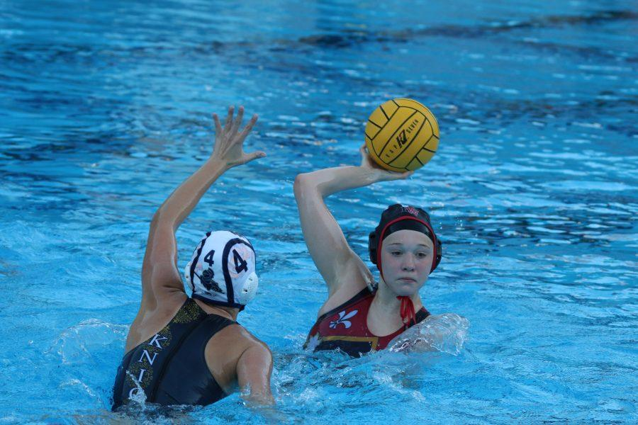 Paige Thompson '17 passes to a teammate during the team's match against Notre Dame. Credit: Pavan Tauh/Chronicle