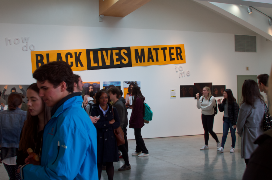 Students, faculty and parents observed the work of Photography III students for their project about Black Lives Matter. Credit: Kaitlin Musante/Chronicle