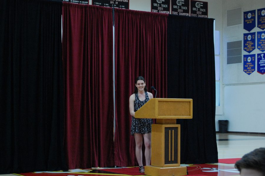 Future Head Prefect Julia Cosgrove '18 speaks to the sophomore and junior classes March 29. Credit: Lucas Gelfond