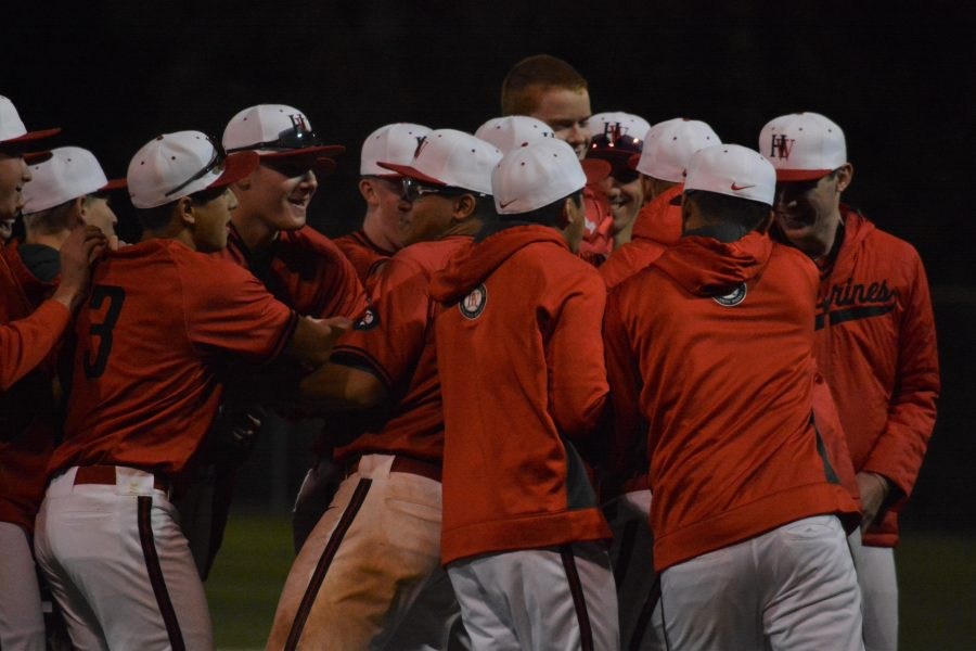 The Wolverines celebrate their tournament victory after defeating Chatsworth 3-1.  Credit: Aaron Park/Chronicle