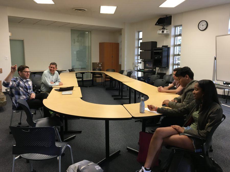 Kutler Center Scholar in Residence Josh Kun '89 speaks to Taylor Redmond '18 and Daniel Varela '18 in the Emery Room. Credit: Sofia Heller/Chronicle