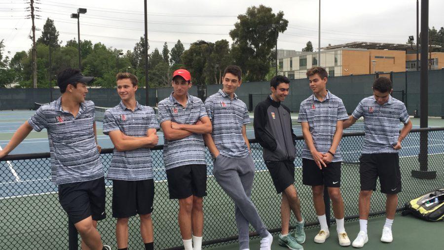 The Boys' Tennis seniors take a moment to enjoy their last season together. Printed with permission of Maria Tucker.