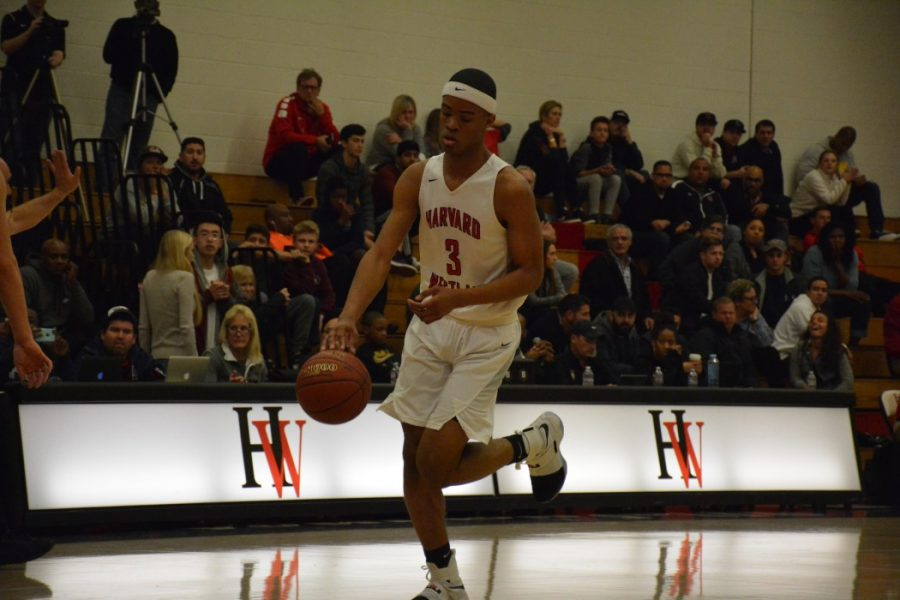Cassius Stanley '19 dribbles up the court in a home contest.  Credit: Aaron Park/Chronicle
