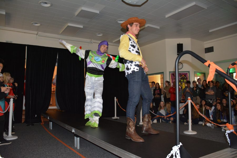 Nico James '19 and Evan LaTourette-Ghez '19 compete in the costume contest. Credit: Sophie Haber/Chronicle