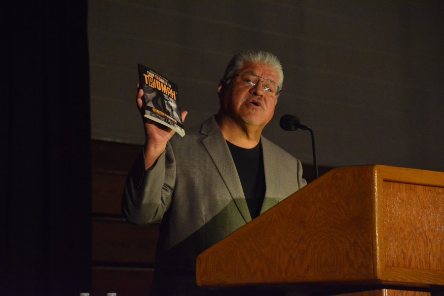 Luis Rodriguez speaks to students and faculty members during an all school assembly. Credit: Alex Goldstein/Chronicle