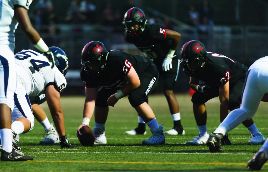 Center Max Ehrlich '19 prepares to snap the ball during a game against Birmingham on Aug. 25. Credit: Pavan Tauh/Big Red