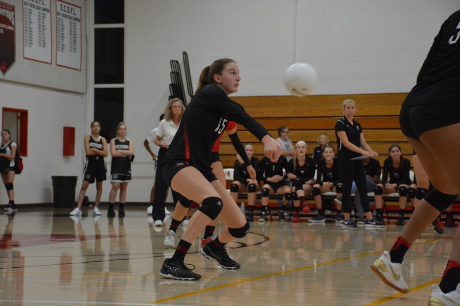 Carly Wallace '20 receives the ball in a game. Photo Credit: Ryan Albert / Chronicle