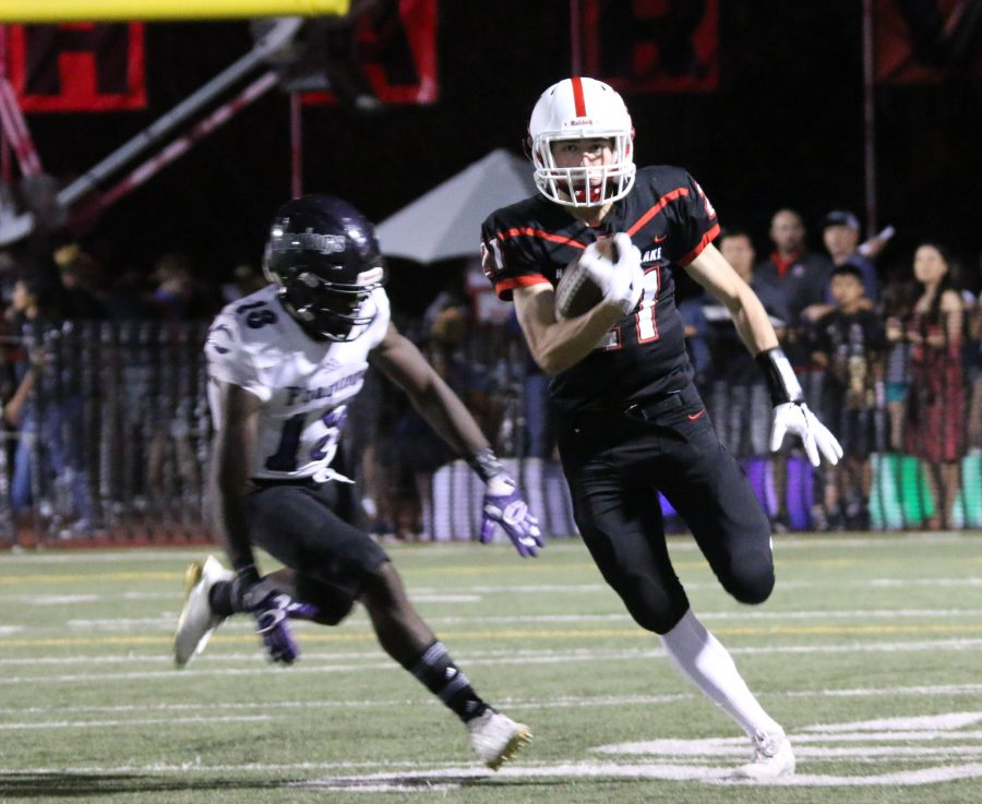 Halfback Jake Kelly '20 runs with the ball in the homecoming game against Cathedral on Oct. 7. Photo Credit: Pavan Tauh '18 / Chronicle