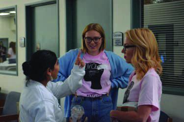 Kate Von Mende '18, Sohni Kaur '17 and Shauna Altieri speak during a break.  Alex Goldstein/Chronicle