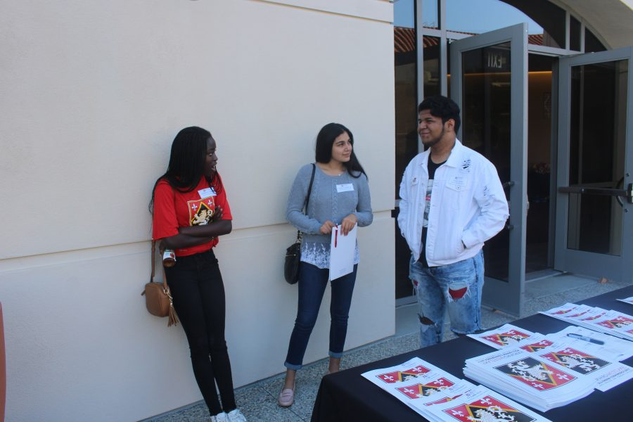 Josephine Amakye '21, Diana Castellanos '20 and Daniel Varela '18 chat at the Pollyanna Conference. Credit:Kaitlin Musante/Chronicle