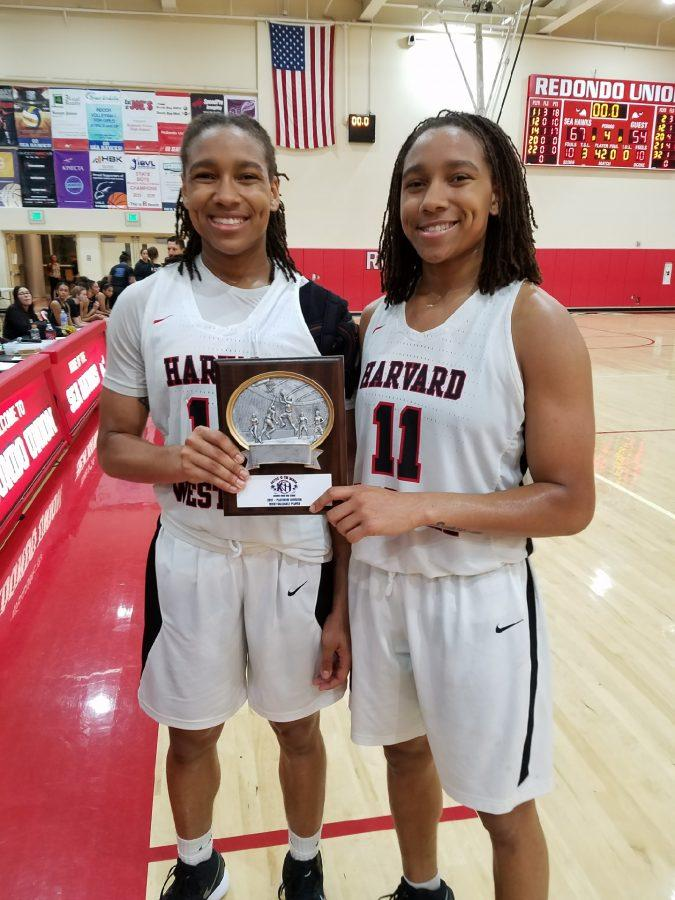 Jayda Rufus-Milner '18 and Jayla Rufus-Milner '18 accept the title. Photo Credit: Nick Koza / MaxPreps