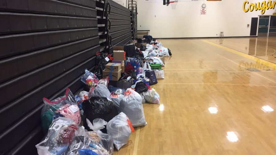 Clothing collected by Kyle and Melissa Hearlihy line the floor of the Ventura High School Gym. Credit: Kyle Hearlihy '19