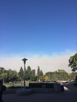 Smoke hovers over campus Tuesday. Students were told to stay inside. Credit: Kaitlin Musante/Chronicle