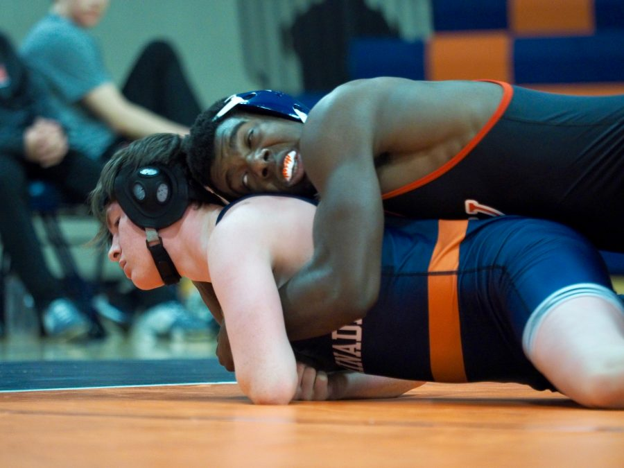 Justin Butler '19 pins an opponent during the match against Chaminade earlier this year. Printed with the permission of Calvin Kaleel '18.