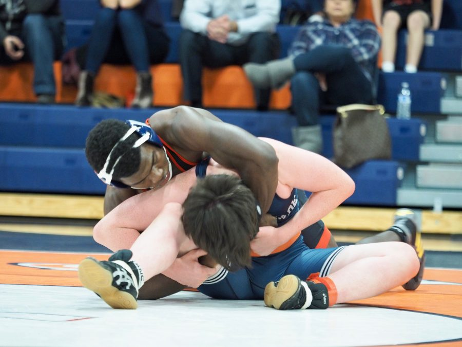Justin Butler '19 locks down his Chaminade opponent from behind.