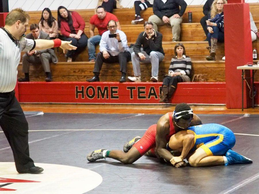 Justin Butler '19 takes down an opponent.