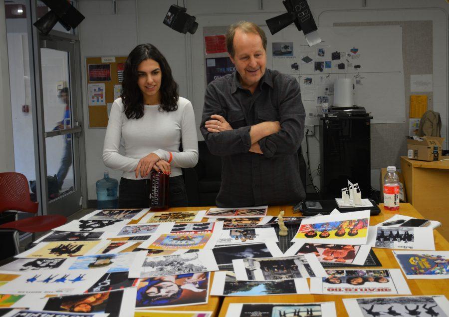 Ava Payman '19 and Fenhagen examine various photos of the Beatles for an upcoming project. Credit: Saba Nia