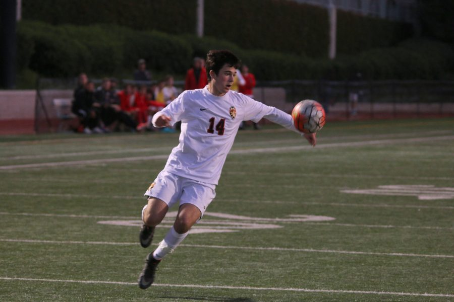 Henry Sanderson '20 receives and controls a pass downfield in a 3-0 victory against St. Francis last season.  Photo Credit: Pavan Tauh/Chronicle