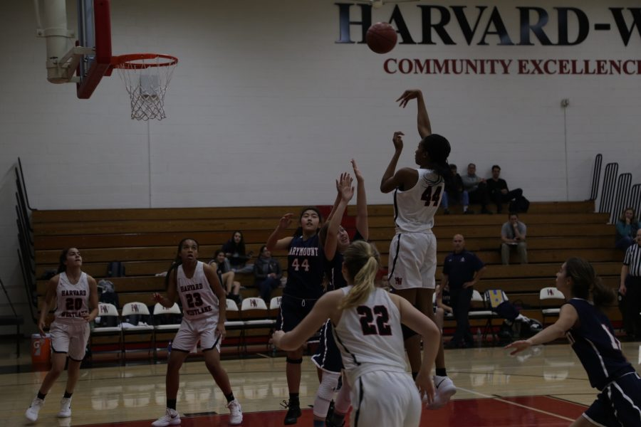 Kiki Iriafen '21 puts up a shot against Marymount. Iriafen led the team in shooting, putting up 18 points through three quarters. Photo Credit: Luke Casola / Chronicle
