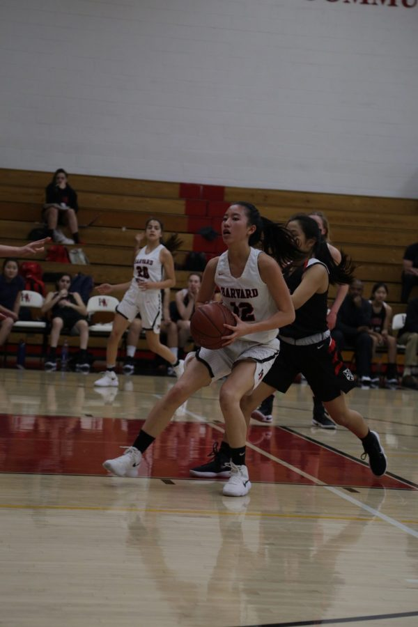 Guard Ashlee Wong '18 attempts to score against Flintridge Sacred Heart.