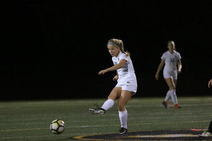 Natalie Phillips 20 looks to pass the ball to a teammate in a victory over Chaminade. Photo Credit: Pavan Tauh/Chronicle