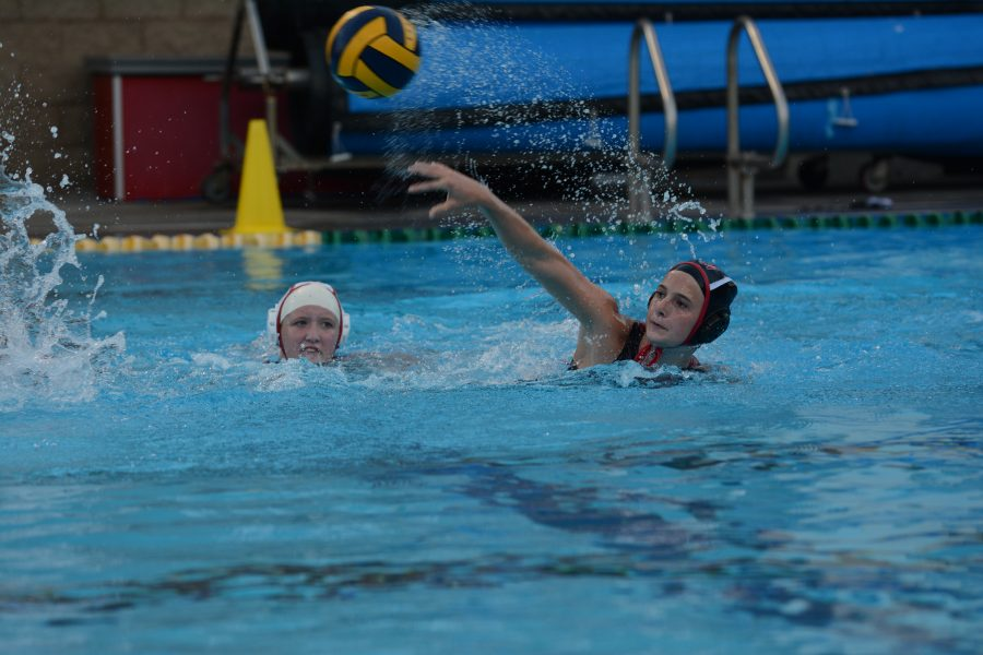 Juliette O'Brien 21 takes a shot on goal during the first league game against Alemany. Photo Credit: Ryan Albert/Chronicle