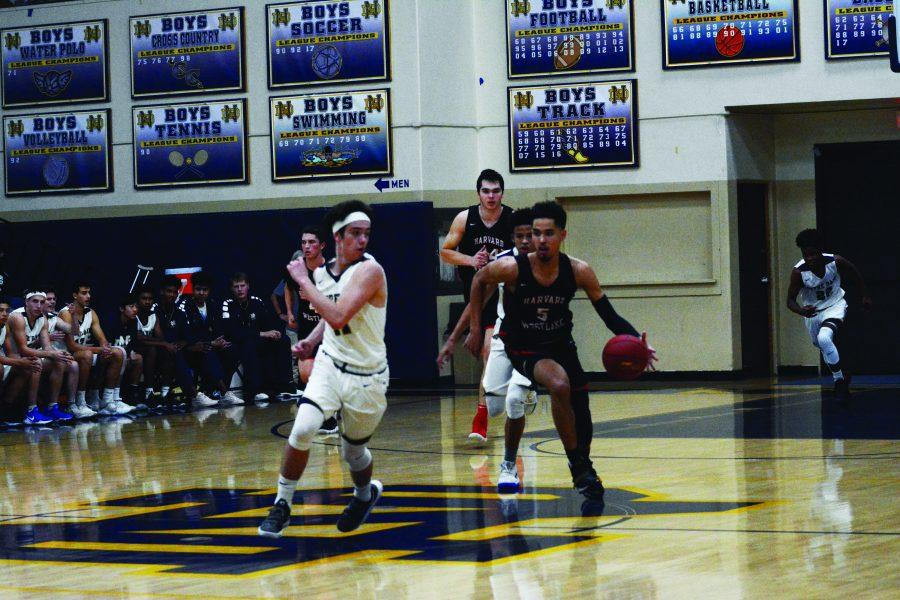 FANTASTIC FORWARD: Forward Johnny Juzang '20 pushes upcourt in a fast break with teammates Simon Pompan '18 and Mason Hooks '20 after stealing the ball in a 63-56 win over rival Notre Dame. Juzang scored 25 points and grabbed 15 rebounds. Photo Credit: Lucas Gelfond / Chronicle