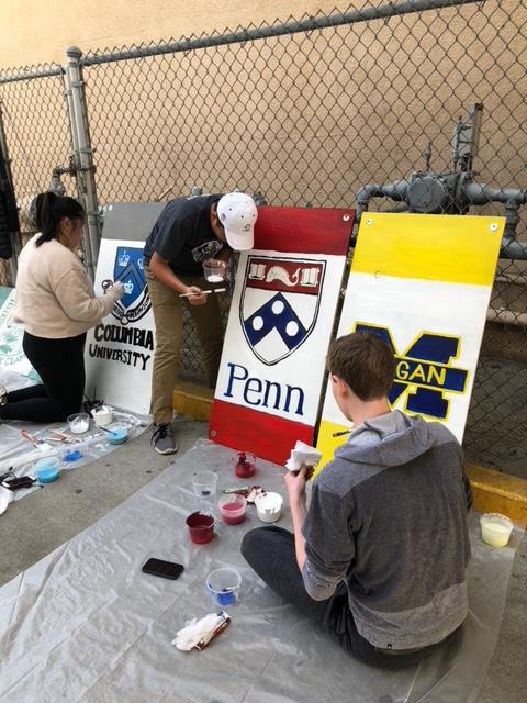 Students paint signs as part of the clean up process at Bethune Middle School. Credit: Printed with permission of Jackie Klein (Andrew Klein '18)