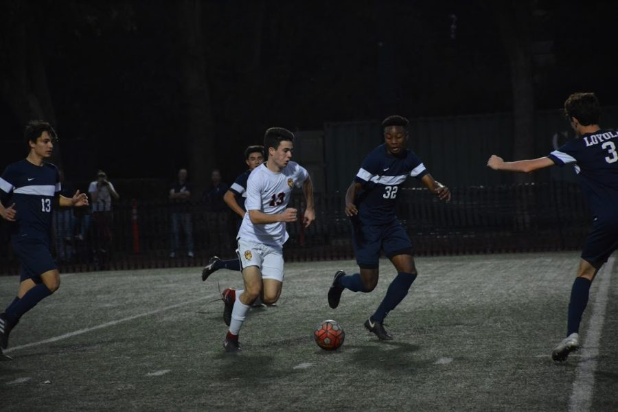 Henry Sanderson '20 takes on multiple defenders in the loss against Loyola. Photo Credit: Ryan Albert '19