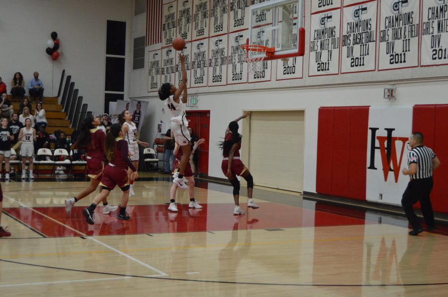 Kiki Iriafen '21 goes up for a clutch basket over Alemany defenders.  Credit: Sophie Haber /Chronicle