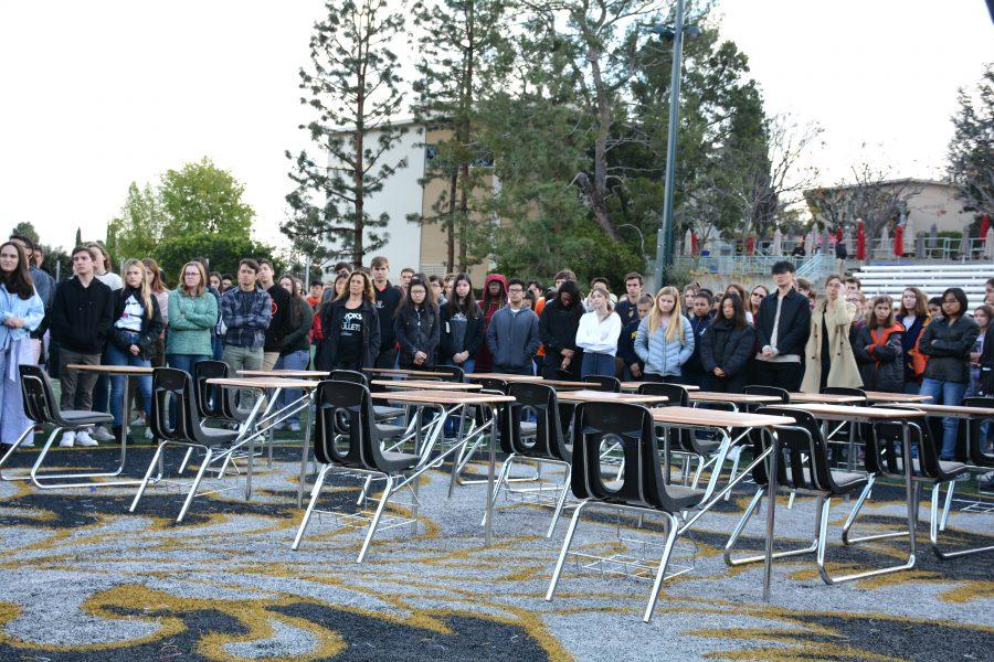 Students walked out onto Ted Slavin Field, where 17 empty desks symbolized the lives lost in the Marjory Stonemason Douglas Shooting in Parkland, Florida. Credit: Sophie Haber/Chronicle