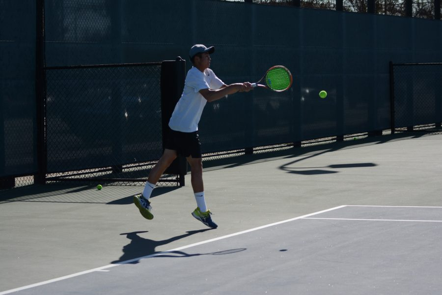 Kenneth Lee '19 hits a shot in the match against St. Francis April 17. Photo Credit: Ben Tenzer/Chronicle