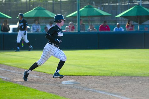 Pete Crow-Armstrong '20 rounds first base in a 4-2 victory over Chaminade on April 11 at O'Malley Field. Photo Credit: Ryan Albert/Chronicle