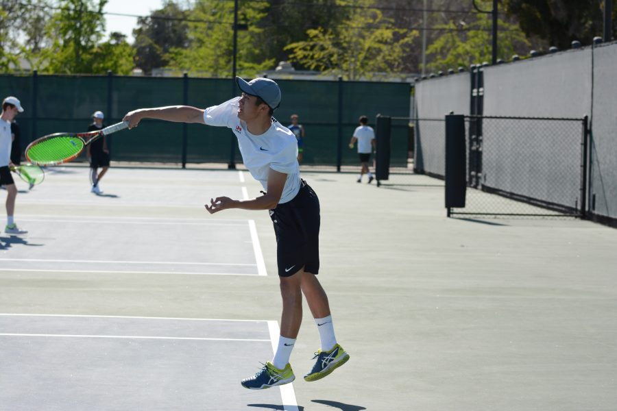 Kenneth Lee '19 serves during the match against St. Francis April 17. Photo Credit: Ben Tenzer/Chronicle
