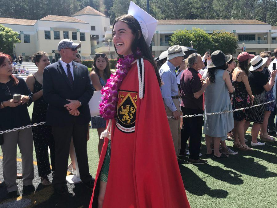 Head Prefect Julia Cosgrove '18 proceeds across Ted Slavin Field before receiving her diploma. Credit: Sophie Haber/Chronicle