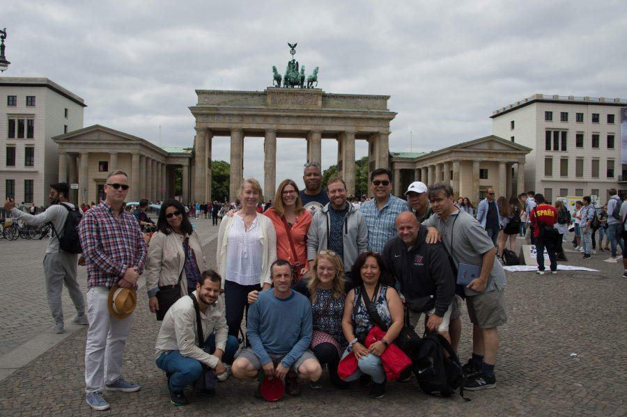 Faculty members from the middle and upper school smile for a group picture.  The trip started in Berlin and lasted for 15 days.  The purpose of the tour was to explore the legacy of World War II and bond as a group. Credit: Ed Hu