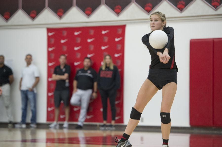 BABY GOT BAXTER:  Senior Captain and Defensive Specialist Eve Baxter '19 bumps the ball in last year's homecoming game, Oct. 7, against league opponent Alemany High School, which the Wolverines won 3-0. The team rose to a 16-6 record following the win.