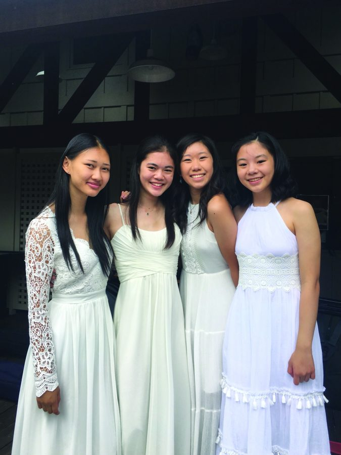 Megan Chang '19  is featured with friends at camp.