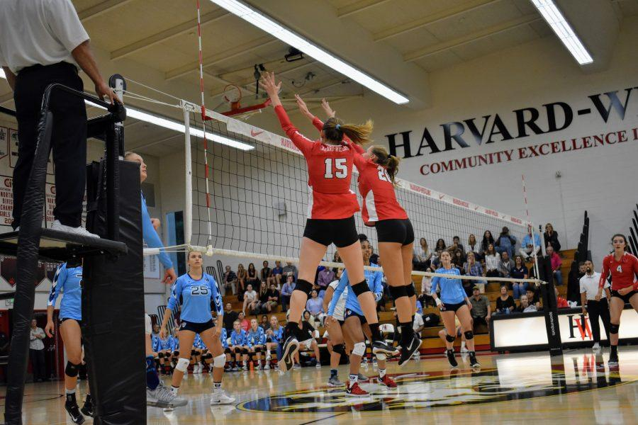 Outside hitter Carly Wallace '20 and middle hitter Caroline Tilton '19 press over the net for a stuff block. (Credit: Astor Wu/Chronicle)