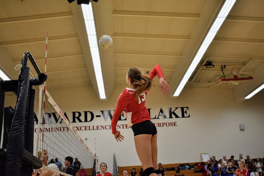 PICK IT UP AND SLAM IT DOWN: Britt Gronemeyer '20 rises up for a spike in Girls Volleyballs 3-0 loss against Marymount High School on Sept. 7 in Taper Gym.  The team returns to play Oct. 4 at home against league rival Notre Dame High School. (Photo credit: Astor Wu/Chronicle)