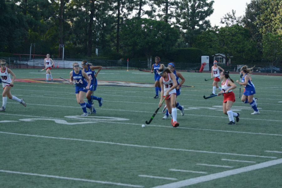 Freshmen Fiene Oerlemans '22 attacks the goal while freshmen Bella Ganocy '22 looks for a pass towards the middle of the field. Oerlemans scored the team's first goal of the game. Photo credit: Luke Casola/Chronicle.