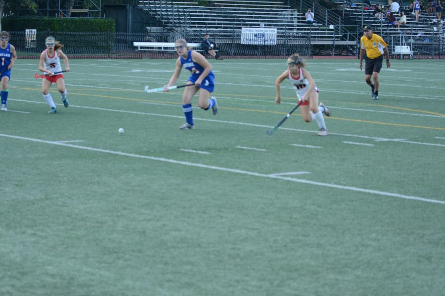 Freshmen Bella Ganocy '22 (#5) and Ella Ganocy '22 (#10) attack the ball trying to take it away from the defender in the 6-0 win against Westlake on Thursday.