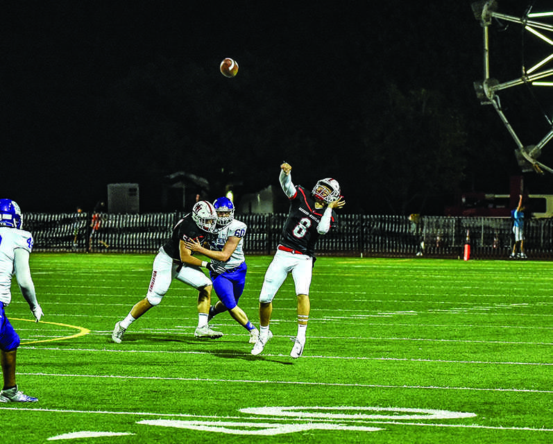 Quarterback Jameson Wang '20 passes in the Homecoming game against St. Anthony High School on Sept. 29. Photo Credit: Ryan Albert/Chronicle