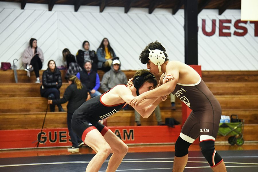 Freshman Paul Boardman '22 competes in the dual against Crespi High School on Dec. 5. The Wolverines lost 36-24 to the Celts at the dual. Currently, the squad is preparing for the league finals on Saturday and CIF Championships on Feb. 8.