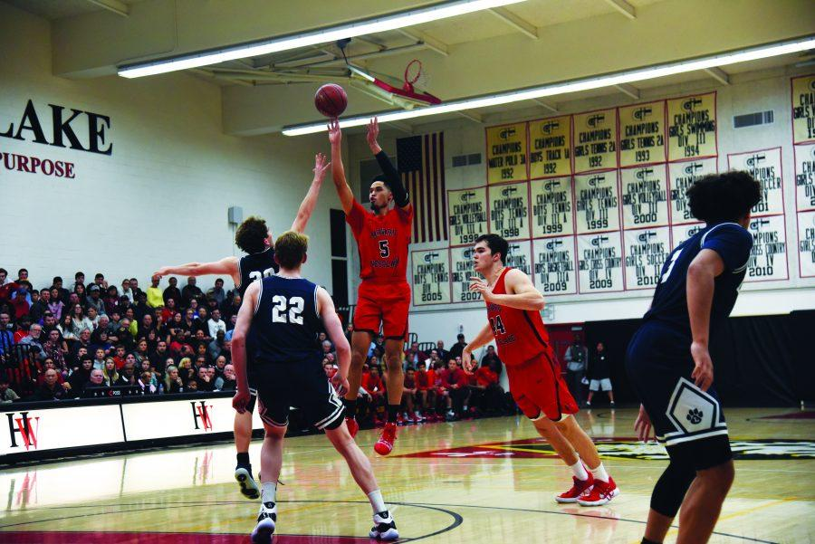 Guard Johnny Juzang '20 releases a jump shot from the top of the key on Jan. 11 in Taper Gymnasium. The Wolverines fell to the Cubs 66-61 in their first matchup of the season.